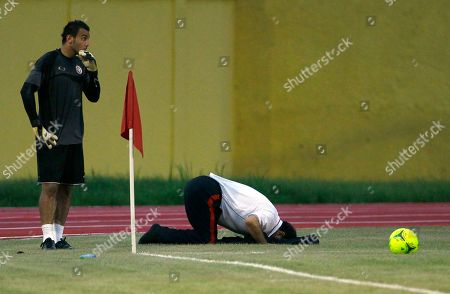 Aymen Mathlouthi Tunisia goalkeeper Aymen Mathlouthi, left, waits to kick a ball as a member of staff prays during a training session ahead of their African Cup of Nations Group C soccer match at INJS Stadium in Libreville, Gabon