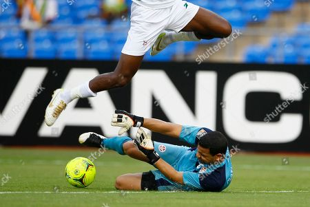 Aymen Mathlouthi, Maazou Moussa Ouwo Tunisia goalkeeper Aymen Mathlouthi tries to stop the ball as Niger Maazou Moussa Ouwo jumps during their African Cup of Nations Group C soccer match at Stade De L'Amitie in Libreville, Gabon