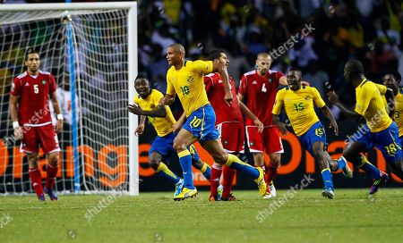 Gabon Daniel Cousin celebrates after scoring a goal against Morocco during their African Cup of Nations Group C soccer match at Stade De L'Amitie in Libreville, Gabon