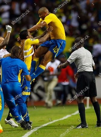 Daniel Cousin Gabon Daniel Cousin celebrates with tesamates after scoring a goal against Morocco during their African Cup of Nations Group C soccer match at Stade De L'Amitie in Libreville, Gabon