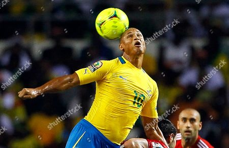 Gabon Daniel Cousin heads the ball front of Morocco players during their African Cup of Nations Group C soccer match at Stade De L'Amitie in Libreville, Gabon