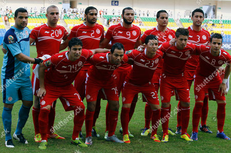 Tunisia soccer team, from left top, goalkeeper Aymen Mathlouthi, Aymen Abdennour, Bilel Ifa, Ammar Jemal, Karim Haggui, and front from left, Mejdi Traoui, Zouhaier Dhaouadi, Amine Chermiti, Youssef Msakni, Khaled Korbi pose prior to the African Cup of Nations Group C soccer match against Niger at Stade De L'Amitie in Libreville, Gabon