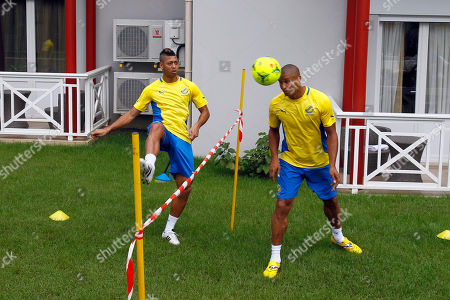 Llyod Palun, Daniel Cousin Gabon Llyod Palun, left, and Daniel Cousin play a tennis football in the courtyard of their hotel in Libreville, Gabon, during preparation of their next African Cup of Nations Group C soccer match against Tunisia in Franceville