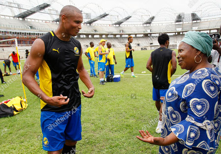 Daniel Cousin, Patience Dabany Gabon musician and singer, former First Lady and mother of the current President of Gabon Ali Bongo Ondimba, Patience Dabany, right, greets Gabon's striker Daniel Cousin during a training session at Omnisport stadium ahead of their African Cup of Nations quarter final soccer match against Mali in Libreville, Gabon