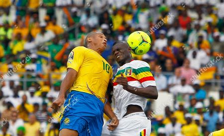Stock Photo of Drissa Diakite, Daniel Cousin Gabon Daniel Cousin is challenged to a high ball by Mali's Drissa Diakite during their African Cup of Nations quarter final soccer match at Stade De L'Amitie in Libreville, Gabon
