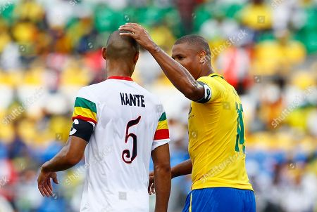 Cedric Kante, Daniel Cousin Gabon's captain Daniel Cousin, right greets Mali's captain Cedric Kante during their African Cup of Nations quarter final soccer match at Stade De L'Amitie in Libreville, Gabon