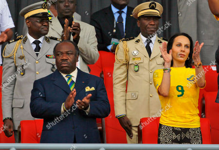 Ali Bongo Ondimba, Sylvia Najma Bongo Gabon President Ali Bongo Ondimba, left, and his wife Sylvia Najma Bongo wearing the Yellow jersey of the Panthers react during their African Cup of Nations quarter final soccer match Gabon vs Mali at Stade De L'Amitie in Libreville, Gabon