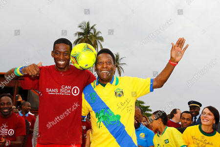 Pele, Sylvia Bongo, Armand Igor Massande Brazilian soccer legend Pele wearing Gabon's national soccer team jersey, center right, poses with Gabon soccer juggler Armand Igor Massande, left, as Gabon's first lady Sylvia Bongo, right, looks, during soccer animations on the beach as part of the African Cup of Nations in Libreville, Gabon