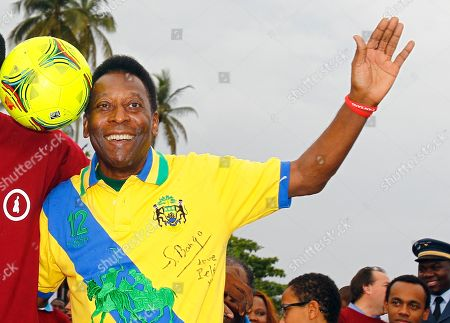 Pele Brazil's soccer legend Pele wearing Gabon's national soccer team jersey signed by Gabon's first lady Sylvia Bongo poses during soccer animations on the beach as part of the African Cup of Nations in Libreville, Gabon