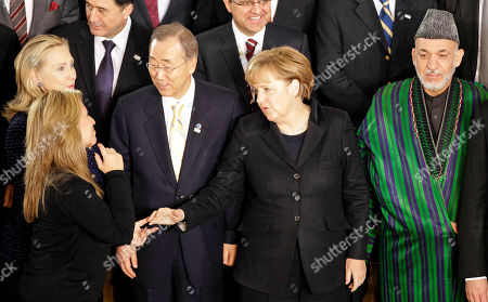 US Secretary of State Hillary Rodham Clinton, from left, Spain's Foreign Minister Trinidad Jimenez, UN Secretary General Ban Ki-moon, German Chancellor Angela Merkel and Afghanistan President Hamid Karzai pose for a group photo at the former German parliament during the International Afghanistan Conference, in Bonn, Germany