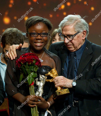 Rachel Mwanza, Paolo Taviani Actress Rachel Mwanza, left, and director Paolo Taviani, right, hold their their Golden and Silver Bears after the Awarding Ceremony at the 62 edition of International Film Festival Berlinale, in Berlin