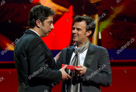 Miguel Gomes, Francois Ozon Portuguese director Miguel Gomes is being awarded with the Alfred Bauer Prize by Jury Member Francois Ozon, right, during the Awarding Ceremony at the 62 edition of International Film Festival Berlinale, in Berlin