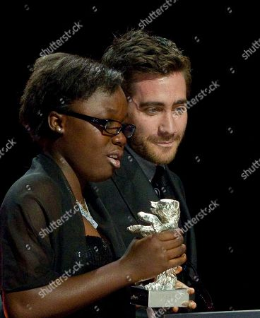 Jake Gyllenhaal, Rachel Mwanza Actress Rachel Mwanza, left, receives the Silver Bear for the Best Actress from Jury Member Jake Gyllenhaal, right, during the Awarding Ceremony at the 62 edition of International Film Festival Berlinale, in Berlin