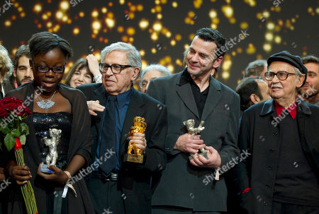 Rachel Mwanza, Paolo Taviani, Christian Petzhold, Vittorio Taviani Actress Rachel Mwanza, directors Paolo Taviani, Christian Petzhold and Vittorio Taviani, from left, hold their Golden and Silver Bears during the Awarding Ceremony at the 62 edition of International Film Festival Berlinale, in Berlin