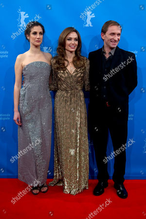 Angelina Jolie, Brad Pitt U.S. director and actress Angelina Jolie is flanked by Bosnian actor Goran Kostic, right, and Bosnian actress Zana Marjanovic as they arrive for the screening of the film In the Land of Blood and Honey at the 62 edition of International Film Festival Berlinale, in Berlin