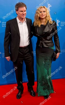 Stock Picture of Angelina Jolie, Brad Pitt German actress Veronika Ferres arrives with her partner Carsten Maschmeyer, left, for the screening of the film In the Land of Blood and Honey at the 62 edition of International Film Festival Berlinale, in Berlin