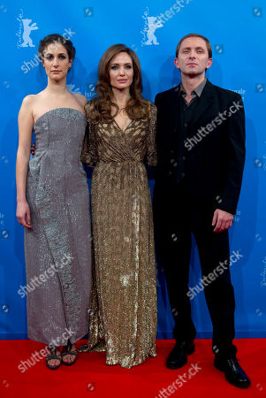 Angelina Jolie U.S. director and actress Angelina Jolie, center, Bosnian actor Goran Kostic, right, and Bosnian actress Zana Marjanovic, left, arrive for the screening of the film In the Land of Blood and Honey at the 62 edition of International Film Festival Berlinale, in Berlin