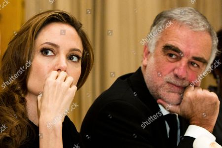 Luis Moreno Ocampo, Angelina Jolie U.S. actress Angelina Jolie, left, and the prosecutor of the International Criminal Court (ICC) Luis Moreno Ocampo attend a press workshop of the ICC in Berlin