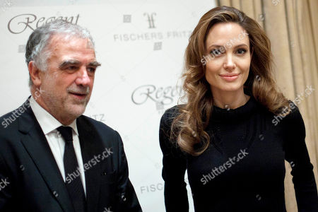 Luis Moreno Ocampo, Angelina Jolie U.S. actress Angelina Jolie, right, and the prosecutor of the International Criminal Court (ICC) Luis Moreno Ocampo, left, arrive for a press workshop of the ICC in Berlin