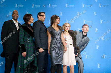 """Christopher Kirby, Stephanie Paul, Timo Vuorensola, Peta Sergeant, Julia Dietze, Goetz Otto Actors Christopher Kirby, Stephanie Paul, director Timo Vuorensola, actresses Peta Sergeant, Julia Dietze and actor Goetz Otto, from left, pose for the photo call of the film """"Iron Sky"""" at the 62 edition of the Berlinale, International Film Festival in Berlin"""