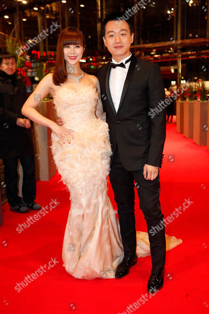 Tong Dawai, Guan Yue Actors Tong Dawai, right, and his wife actress Guan Yue arrive for the screening of the film The Flowers Of War (Jin Ling Shi San Chai) at the 62 edition of the Berlinale, International Film Festival in Berlin