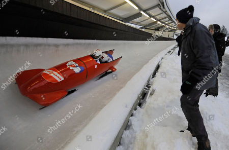 Thibault Godefroy, Alexandre Jolivet A visitor watches the French bob with Thibault Godefroy, front, and Alexandre Jolivet racing down the course during the two man bob World Cup race in Winterberg, Germany