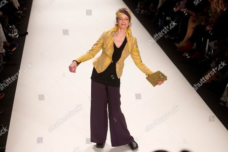 German former top model Veruschka presents a creation by fashion brand Anja Gockel at the Fashion Week in Berlin