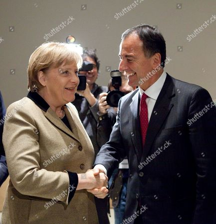 "Angela Merkel, Franco Frattini German Chancellor Angela Merkel, left, welcomes Franco Frattini, right, the former Italian foreign minister, prior to an event of the Konrad-Adenauer-Stiftung called ""Euro - 10 years common currency"" in Berlin, Germany, . Germany's chancellor says her country is prepared to speed up its payments to boost Europe's new bailout fund"