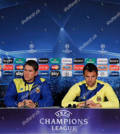 Juan Carlos Garrido, Carlos Marchena Villarreal's head coach Juan Carlos Garrido, left, and defender Carlos Marchena attend a news conference in Munich, southern Germany, . Bayern Munich and Villarreal will play each other on Tuesday in a Champions League Group A soccer match