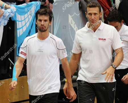 Stock Picture of Philipp Petzschner Germany's Philipp Petzschner, left, comes back from a break followed by coach Patrick Kuehnen in a tennis Davis Cup first round tennis match between Germany and Argentina in Bamberg, Germany