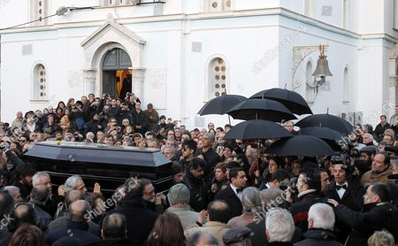 People gather at the funeral of award-winning Greek filmmaker Theo Angelopoulos in Athens, . Angelopoulos, 76, was known for his slow and dream-like directing style, was killed in a road accident Tuesday after being hit by a motorcycle while walking across a road close to a movie set near Athens' main port of Piraeus
