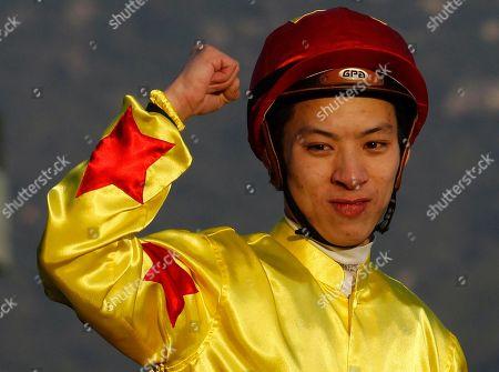Matthew Chadwick Hong Kong jockey Matthew Chadwick riding Hong Kong horse California Memory celebrates after winning the 2,000-meter Cathay Pacific Hong Kong Cup horse race at the Shatin race track in Hong Kong
