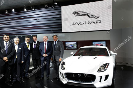 Stock Image of From right, Tata Sons Chairman Ratan Tata, Jaguar design director Ian Callum, Jaguar Land Rover CEO Ralf Speth, Land Rover design director Gerry McGovern, Tata Motors Vice Chairman Ravi Kant and Tata Sons deputy chairman Cyrus Mistry pose for the media during the unveiling of Jaguar and Land Rover vehicles, at the India Auto Expo, in New Delhi, India, . The five day long automobile event begins Saturday