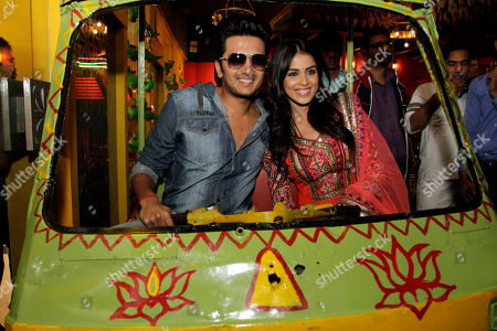 """Ritesh Deshmukh, Genelia D'Souza Newly married Bollywood actors Ritesh Deshmukh, left and Genelia D'Souza sit inside an auto rickshaw and pose for photographs as they arrive to promote their upcoming movie """"Tere Naal Love Ho Gaya"""" in Ahmadabad, India, . The film will be released on Feb. 24"""