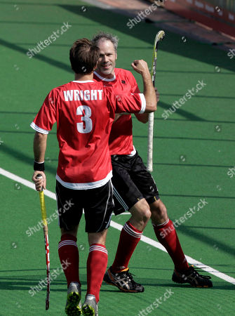 Philip wright, Scott Sandison Canada hockey players Philip wright, back to camera, celebrates with teammate Scott Sandison after scoring a goal against Italy during a hockey Olympic qualifying match in New Delhi, India, . Canada won the match 9-0