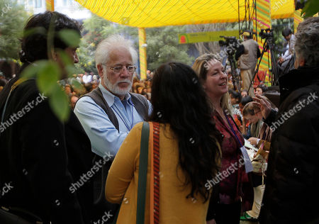 Michael Ondaatje, Katie Hickman Sri Lankan-born Canadian novelist and poet Michael Ondaatje, second left, and English novelist and travel writer Katie Hickman, second right, talk with other writers at the Jaipur Literature Festival, in Jaipur, in the western Indian state of Rajasthan, India