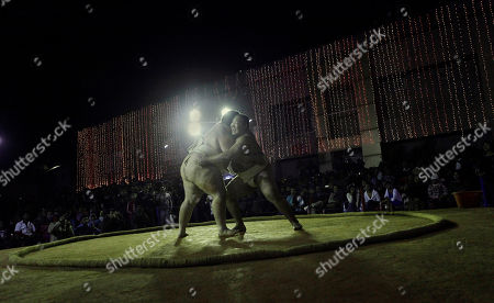 Stock Picture of Kelly Gneiting, three times US champion, left, fights with Byambajav Ulambayar, the reigning World champion during an exhibition Sumo wrestling match in Gauhati, India