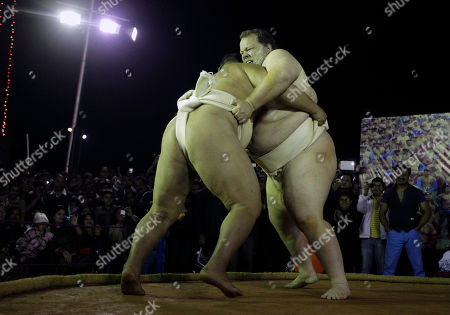 Stock Image of Kelly Gneiting, three times US champion, left, fights with Byambajav Ulambayar, the reigning World champion during an exhibition Sumo wrestling match in Gauhati, India