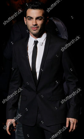 Italian actor Primo Reggiani poses prior to the start of the Dolce&Gabbana men's Fall-Winter 2012/2013 collection, part of the Milan Fashion Week, unveiled in Milan, Italy, Saturday, Jan.14, 2012