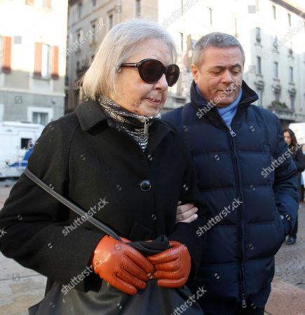Italian journalists Natalia Aspesi, left, and Ezio Mauro attend the funerals of Italian journalist and writer Giorgio Bocca at the San Vittore al Corpo church, in Milan, Italy, Tuesday, Dec.27, 2011