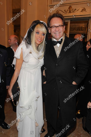 Stock Photo of Sabina Negri and Alessandro Cecchi Paone arrive at the Milan La Scala theater, Italy, . Mozart's Don Giovanni, led by director Daniel Baremboin, will inaugurate the Milan's opera house season Wednesday