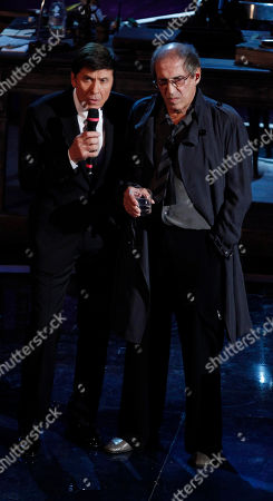 Italian show host Gianni Morandi, left, and Italian singer Adriano Celentano perform during the 62nd edition of the Sanremo Song Festival, in Sanremo, Italy