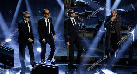 Italian singer Adriano Celentano, right, preform with Italian singer Pupo, left, Italian actor Rocco Papaleo and Italian show host Gianni Morandi during the 62nd edition of the Sanremo Song Festival, in Sanremo, Italy