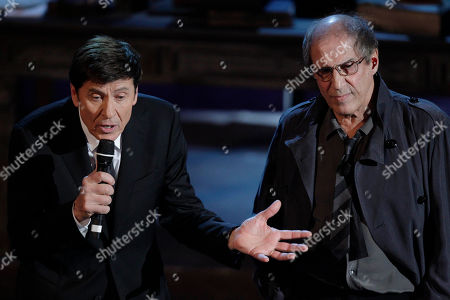 Italian singer Adriano Celentano, right, and Italian show host Gianni Morandi preform during the 62nd edition of the Sanremo Song Festival, in Sanremo, Italy