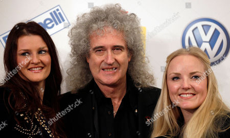 British musician and rock guitarist Brian May, center, poses with Italian singer Irene Fornaciari, left, and British singer Kerry Ellis prior to a press conference at the 62nd edition of the Sanremo Song Festival, in Sanremo, Italy