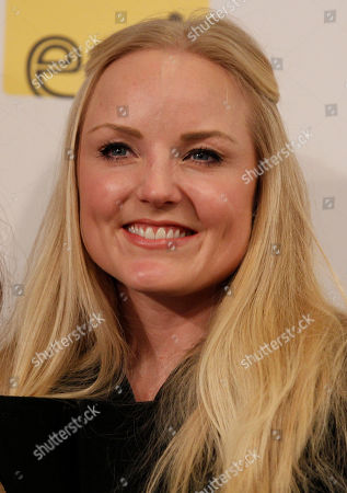British singer Kerry Ellis looks on during a press conference at the 62nd edition of the Sanremo Song Festival, in Sanremo, Italy, . May will play on the stage tomorrow with Italian singer Irene Fornaciari