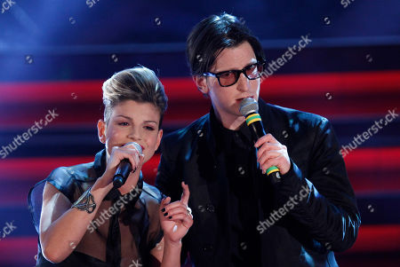 British singer Gary Go, right, performs flanked by Italian singer Emma during the 62nd edition of the Sanremo Song Festival, in Sanremo, Italy