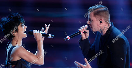 British performer Stephen Paul Manderson, better known by his stage name Professor Green, right, performs with Italian singer Dolcenera during the 62nd edition of the Sanremo Song Festival, in Sanremo, Italy