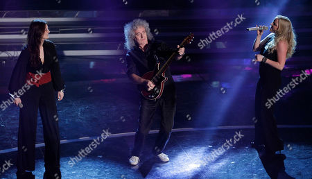 British musician Brian May, center, performs with British singer Kerry Ellis, right, and Italian singer Irene Fornaciari during the 62nd edition of the Sanremo Song Festival, in Sanremo, Italy