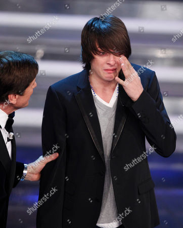 Italian singer Alessandro Casillo cries after he performs during the 62nd edition of the Sanremo Song Festival, in Sanremo, Italy